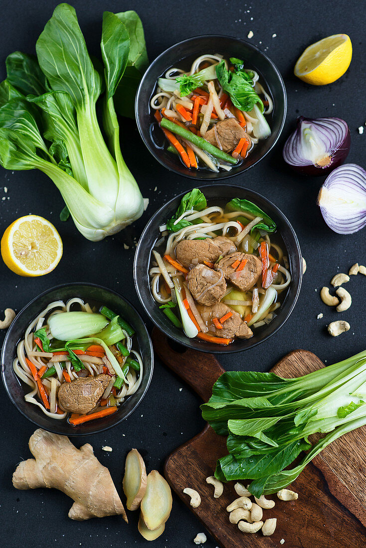 Asian soup with pak choi, noodles, ginger and carrot