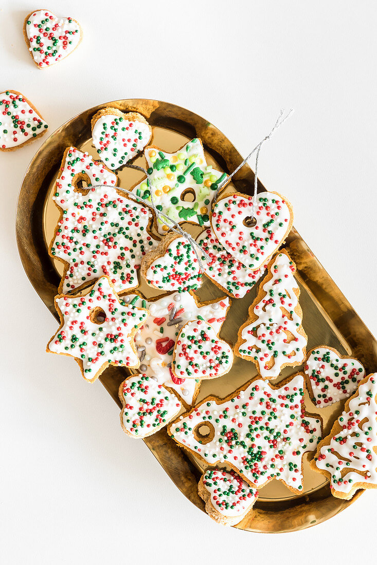 Gingerbread cookies decorated with Christmas sugar sprinkles and royal icing