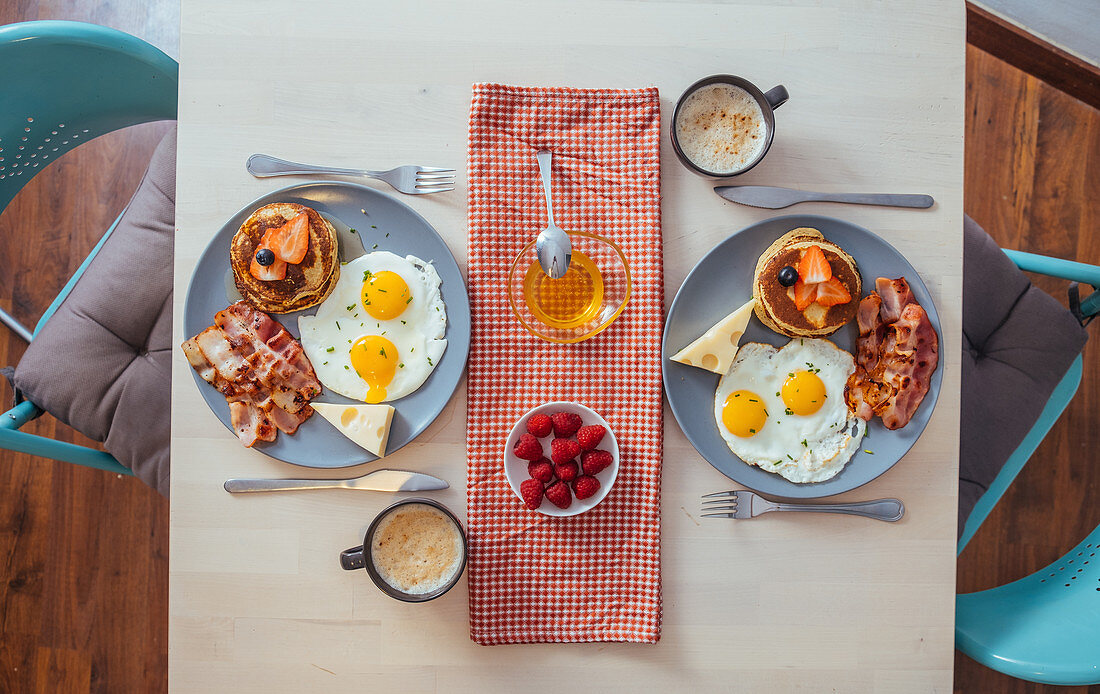 Delicious fried eggs with bacon and cheese for breakfast