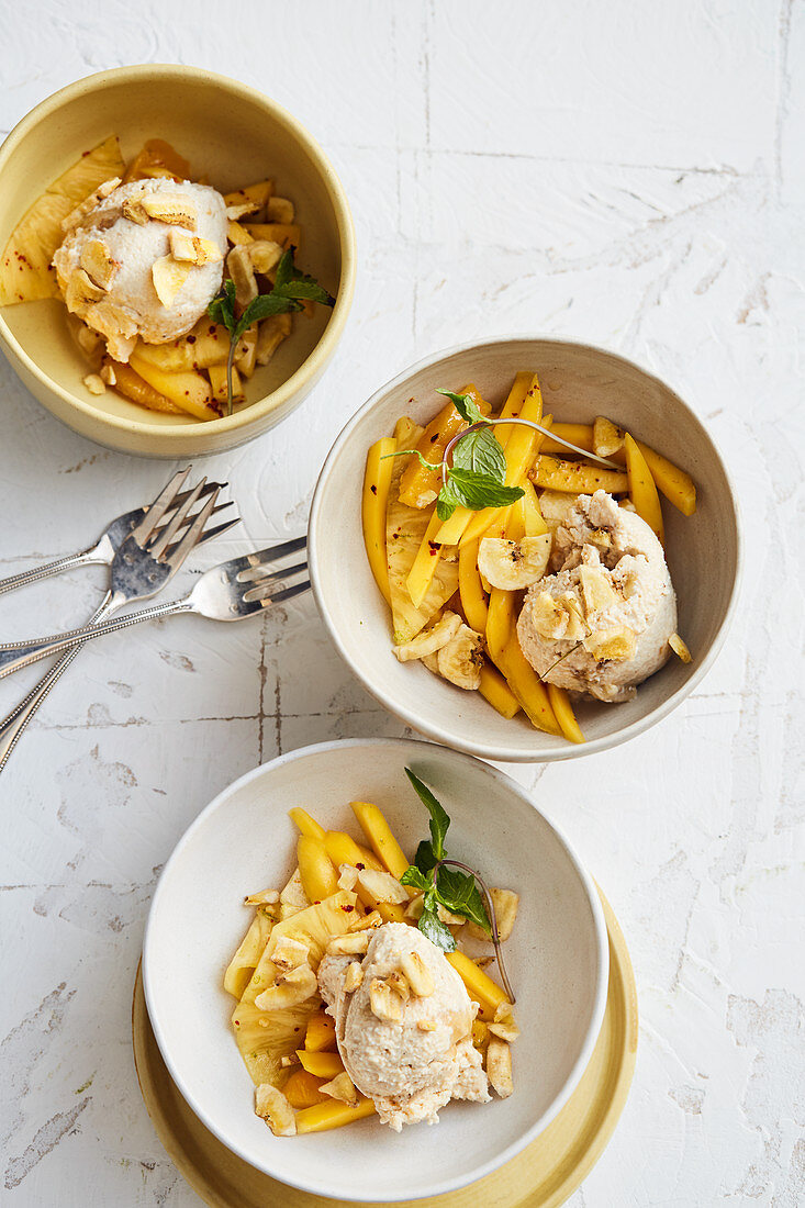 Cashew nut and banana ice cream with a mango and pineapple salad and chillis