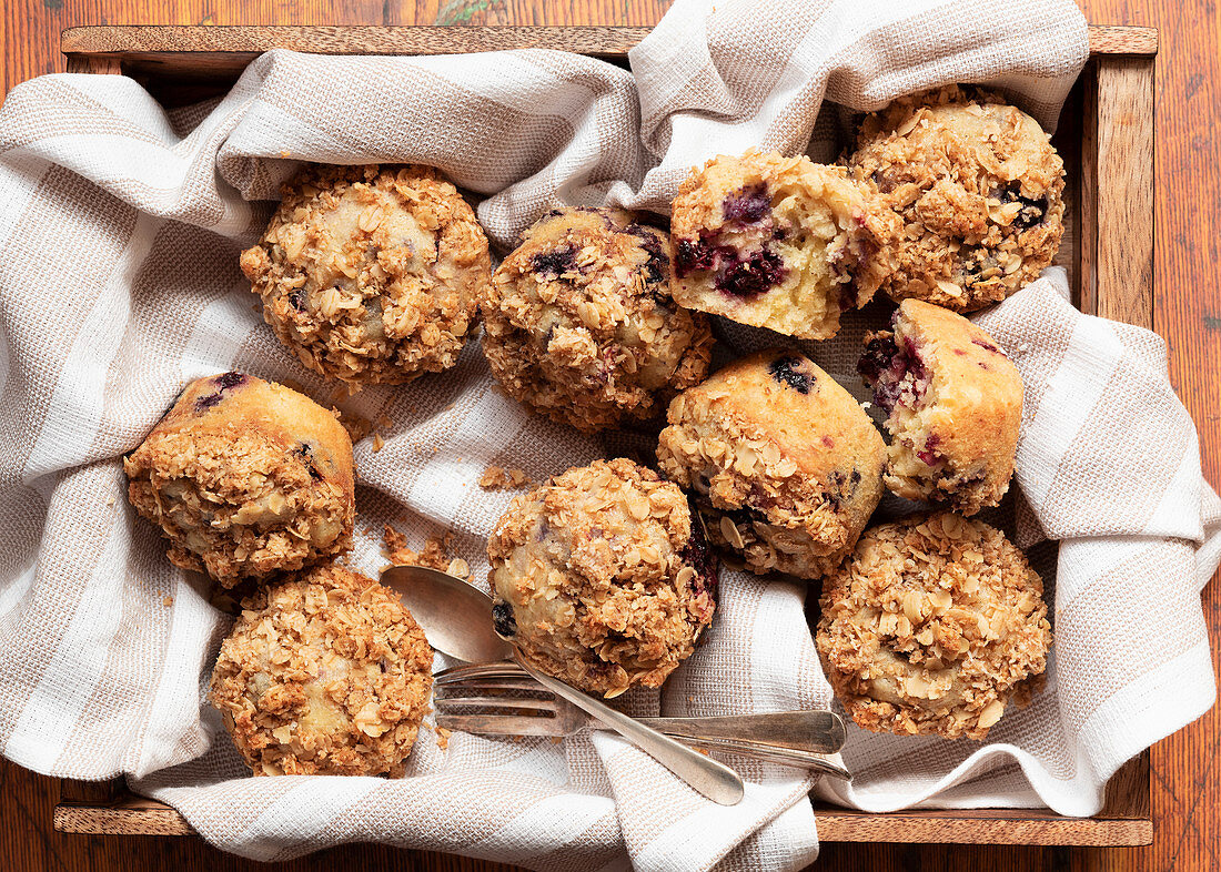 Mixed berry and oat muffins on a wooden tray