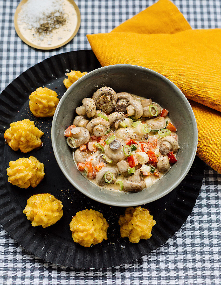 Pepper and mushroom ragout with duchess potatoes