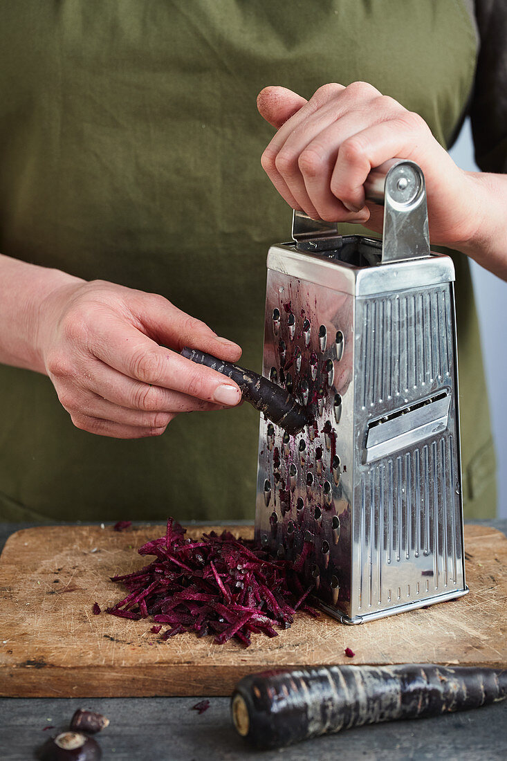 Root vegetables being grated