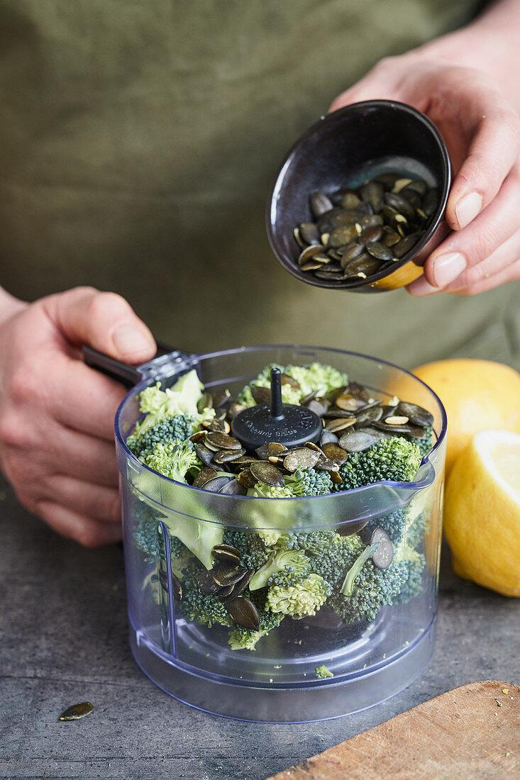 Broccoli and pumpkin seeds in a food processor