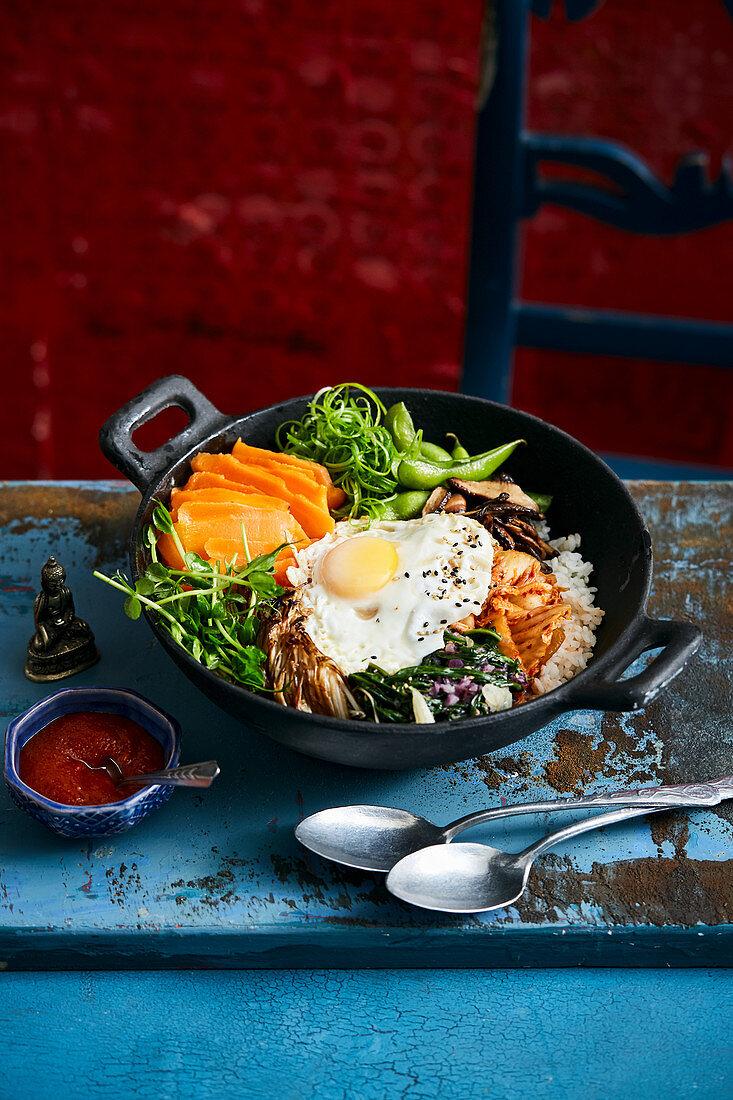 Bibimbap with salmon substitute, vegetables, egg, gochujang paste and rice (Korea)