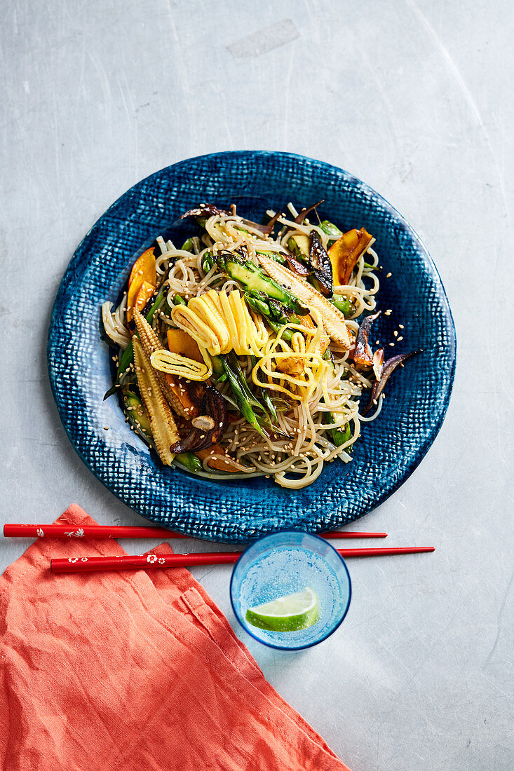 Japchae with fried noodles, vegetables and omelette strips (Korea)
