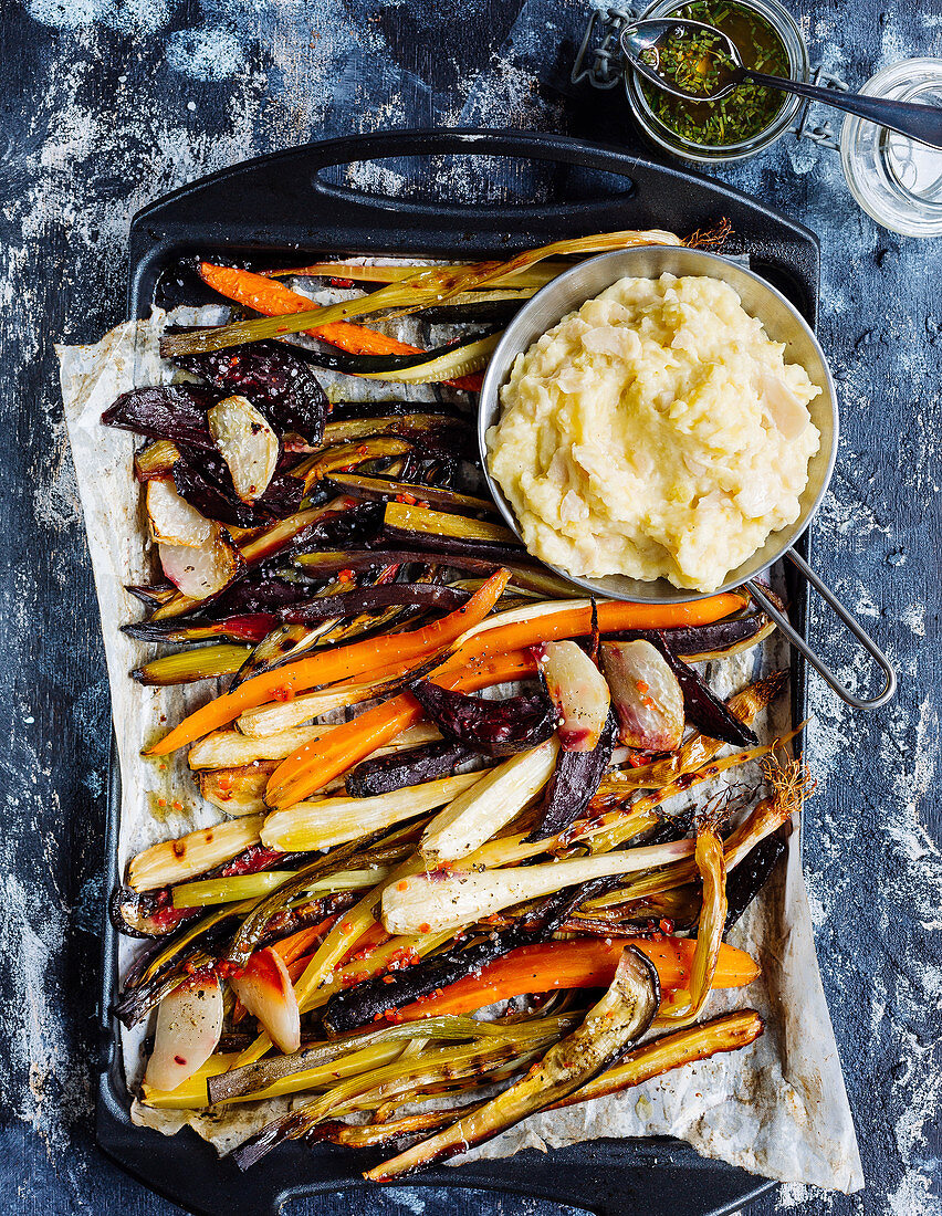 Oven-roasted vegetables on mashed potatoes and beans with chive oil