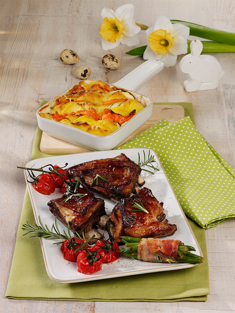 Lamb ribs with vegetable gratin and oven roast tomatoes