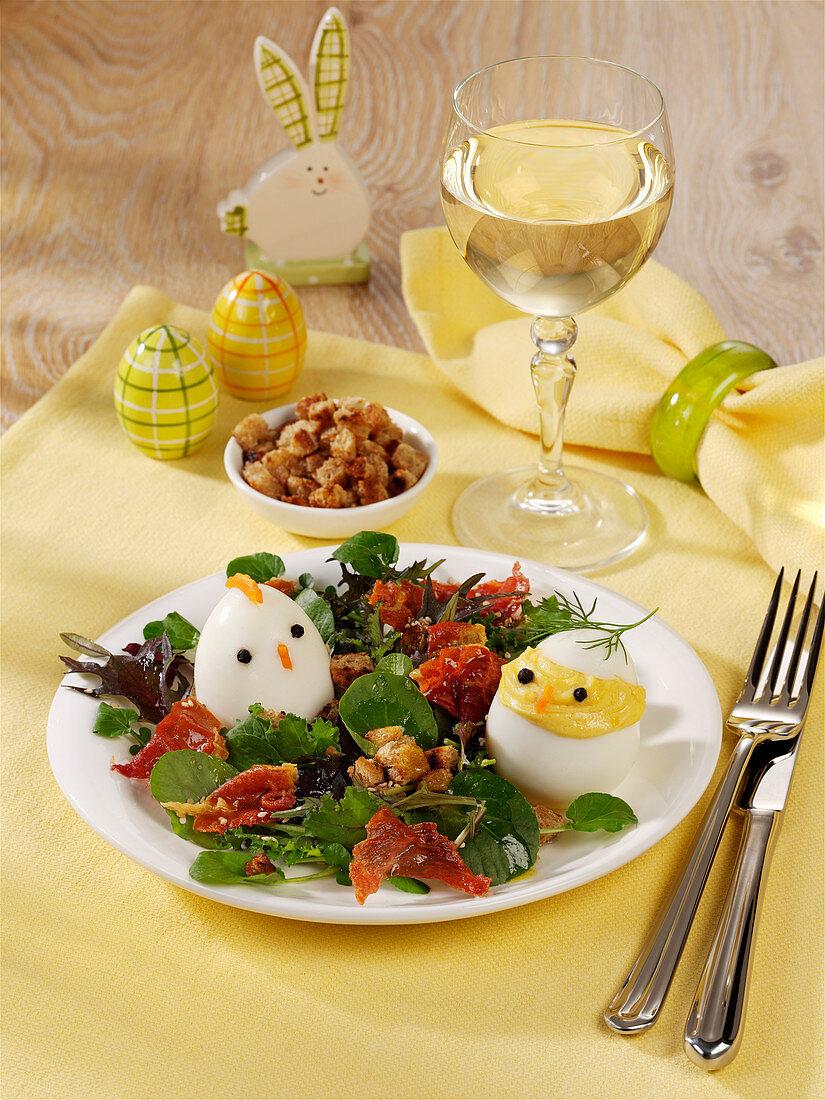Easter chicks: hard-boiled eggs on lettuce