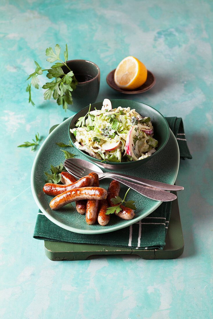 Savoy cabbage salad with sausages
