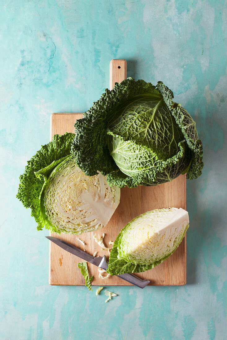 Savoy cabbage, whole and sliced