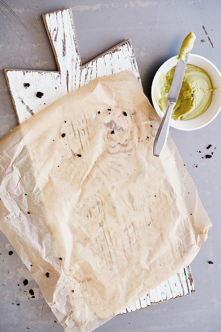 Kitchen board, parchment paper and avocado cream