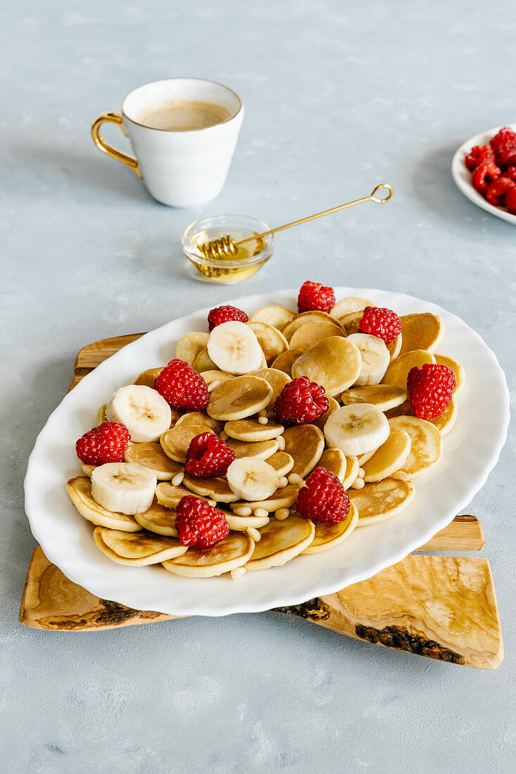 Mini pancakes with raspberry and banana