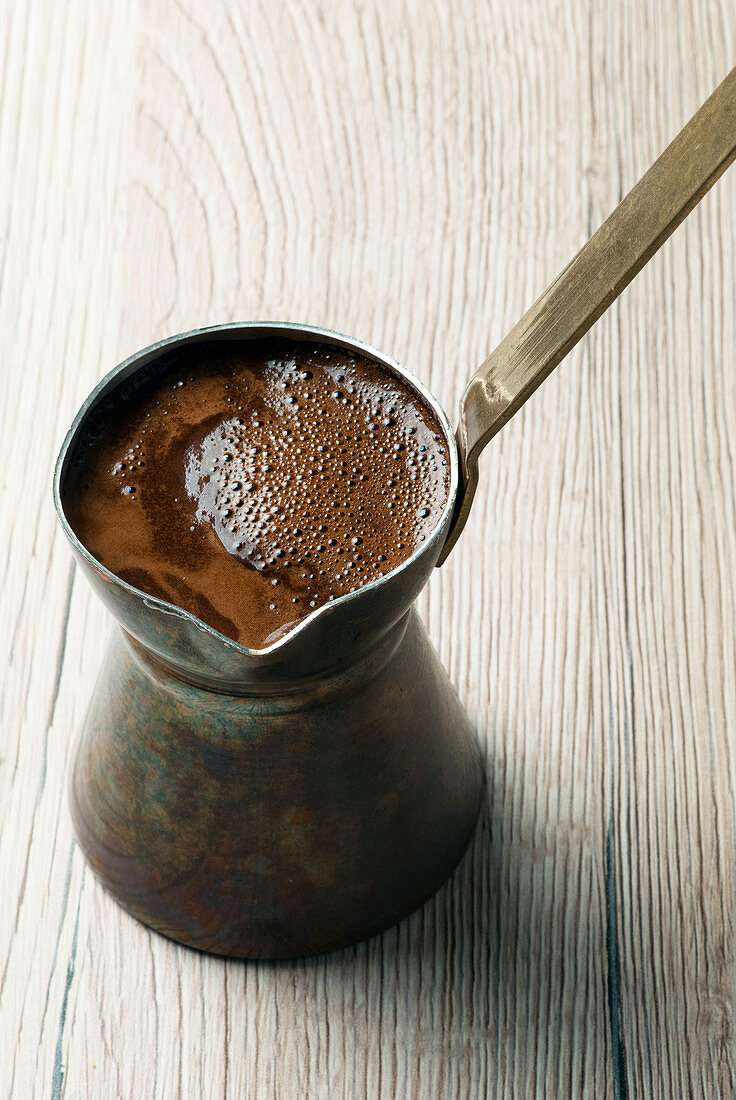 Greek coffee served in traditional copper Briki