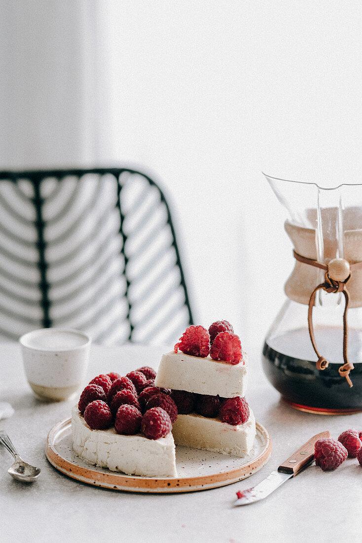Vegan cashew cheesecake with raspberries and coffee