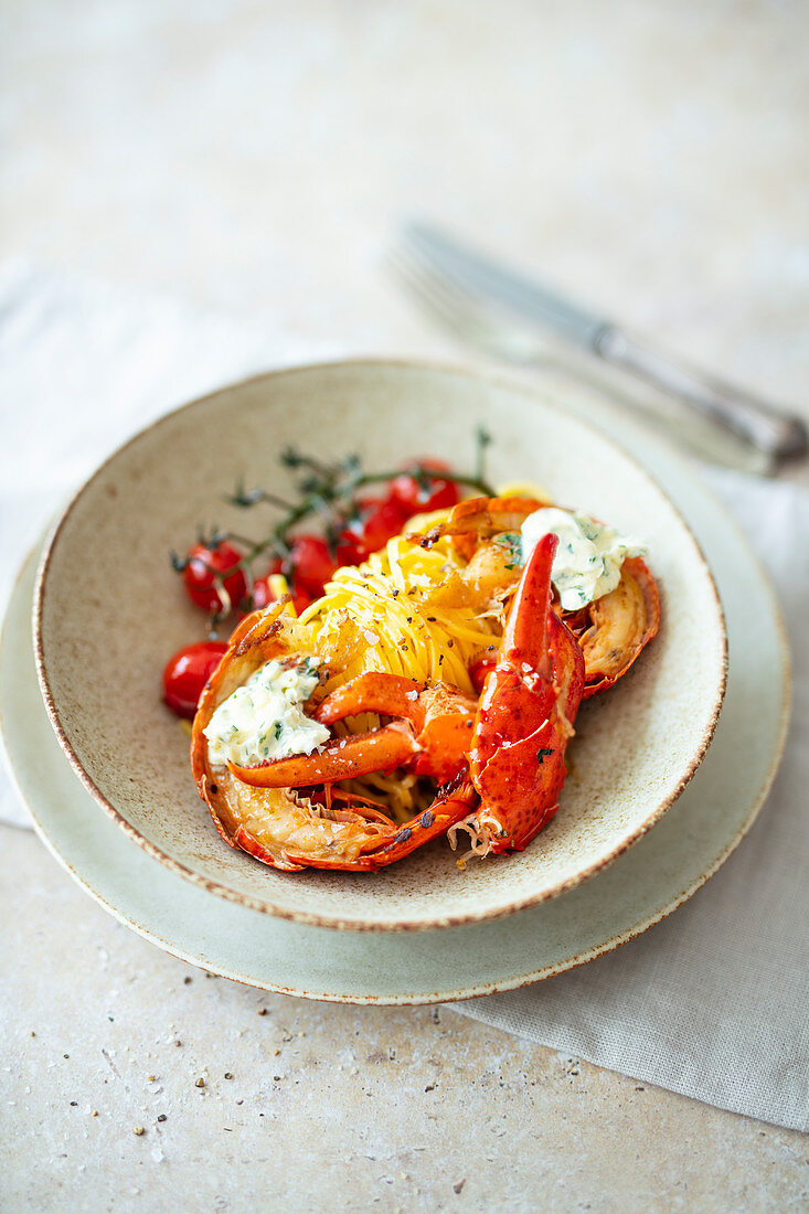 Lobster noodles with garlic, tomatoes and herb butter