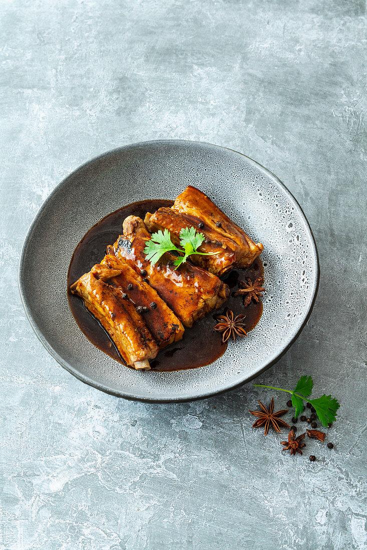 Thai pork ribs with anise, peppercorns, garlic and coriander