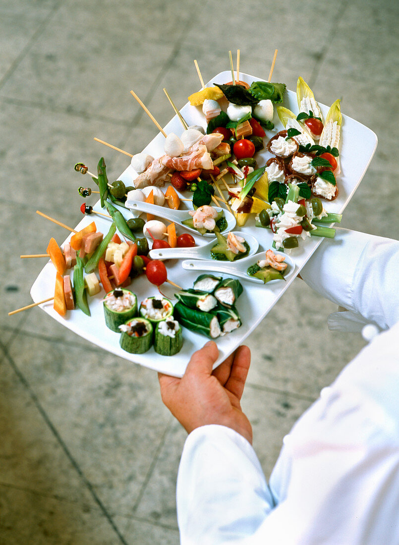 Waiter with a large finger food platter