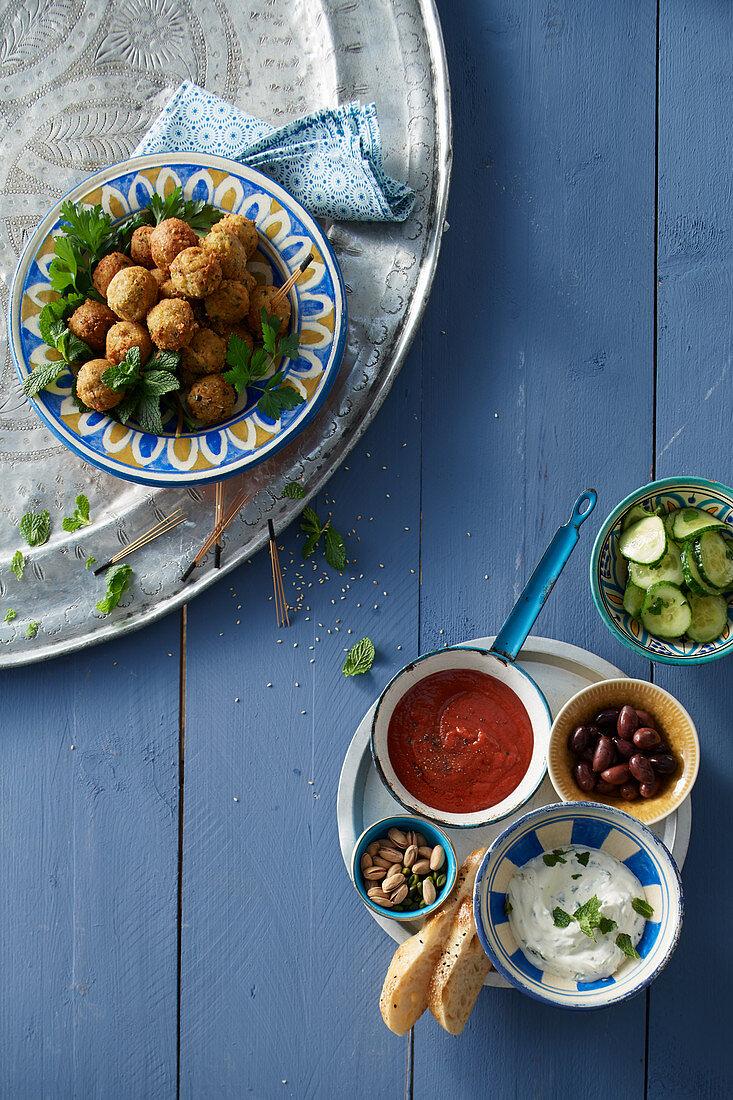 Falafel with tomato dip and mint yogurt