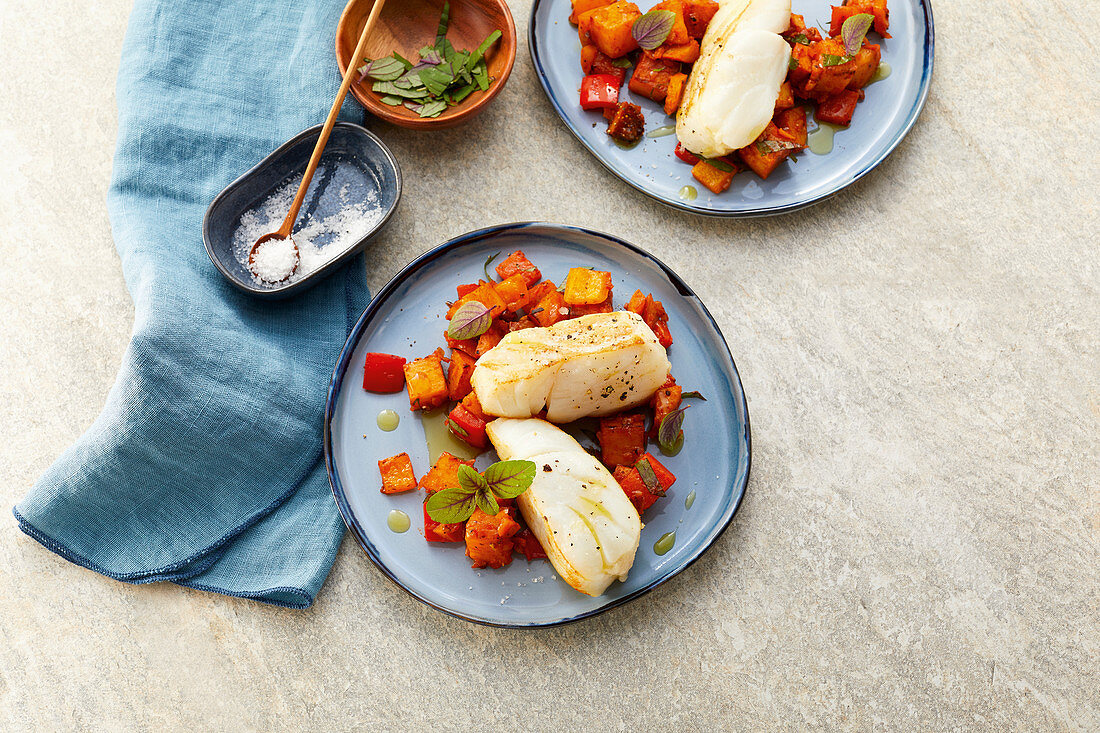 Cod on pepper and potato cubes