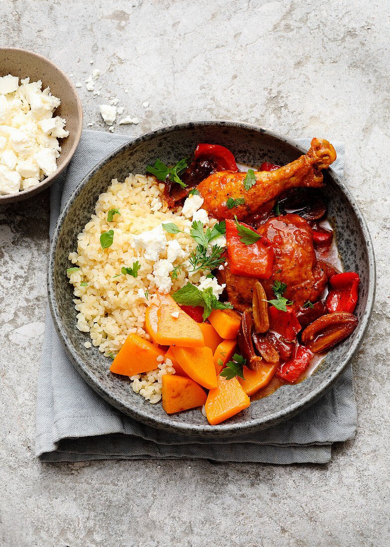Bulgur wheat bowl with bell pepper and date chicken