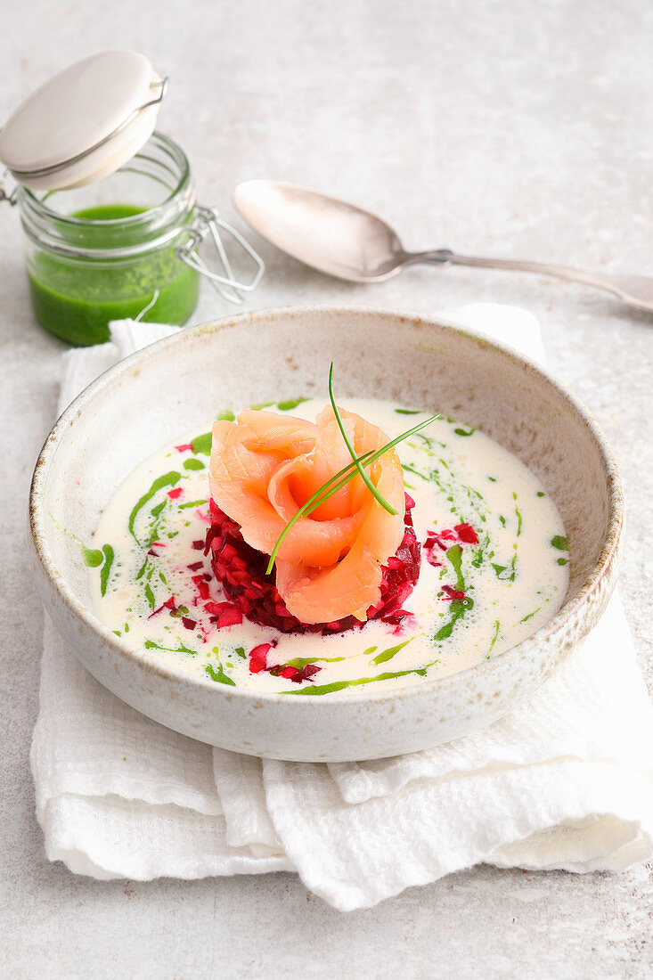 Horseradish foam soup with beetroot tartare and a salmon rose