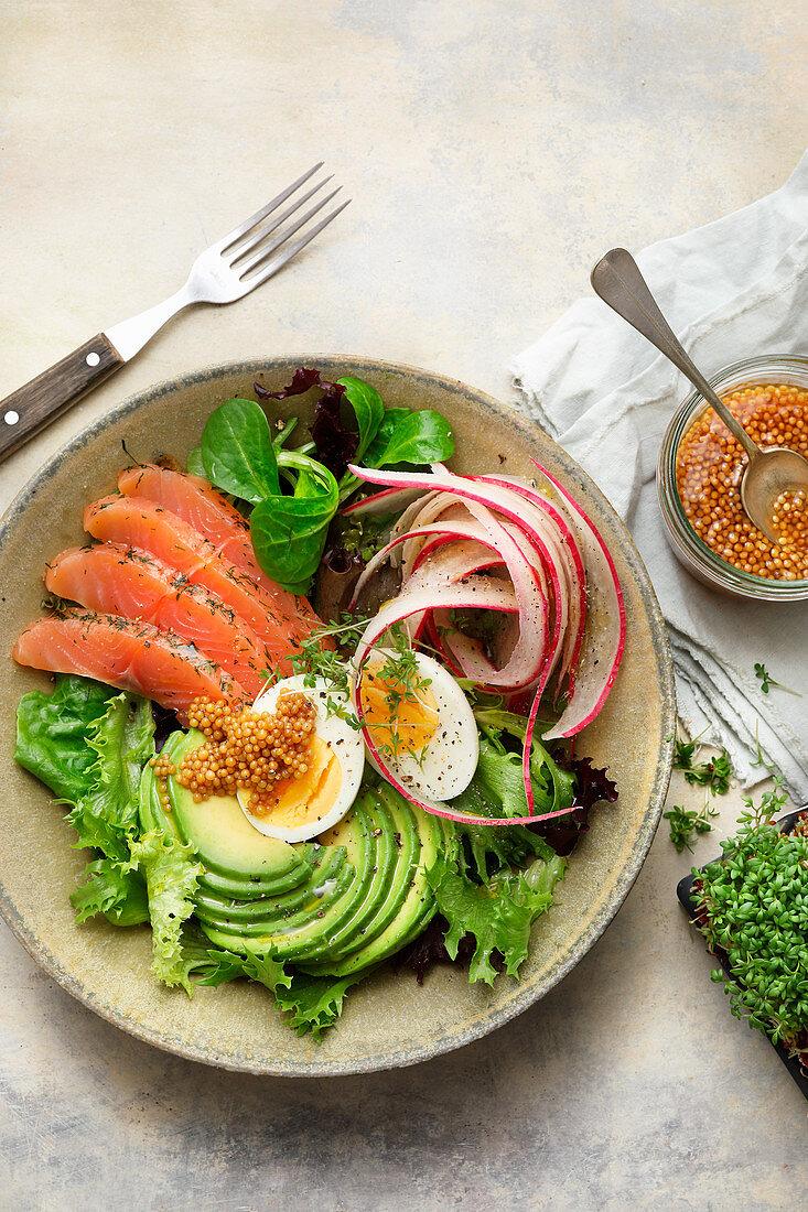 Salad bowl with salmon and avocado