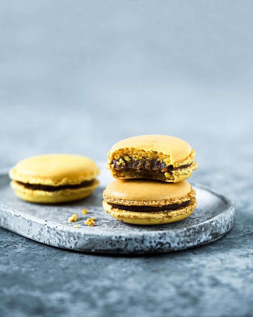 Yellow macaroons with date chocolate cream
