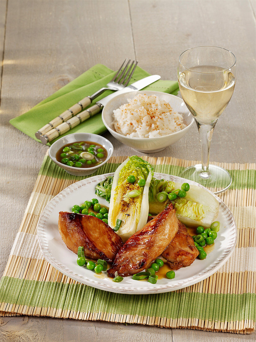 Teriyaki chicken with peas and fried lettuce hearts