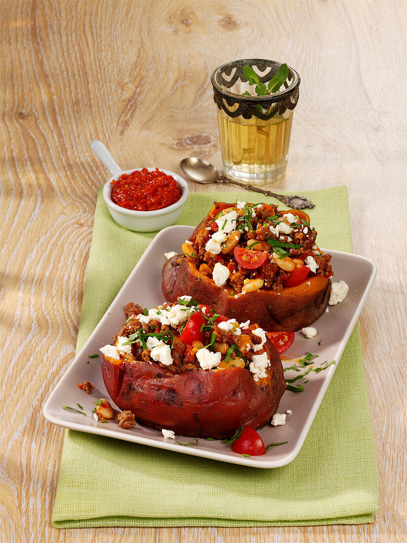 Turkish oven-baked potatoes with a minced meat and feta cheese filling