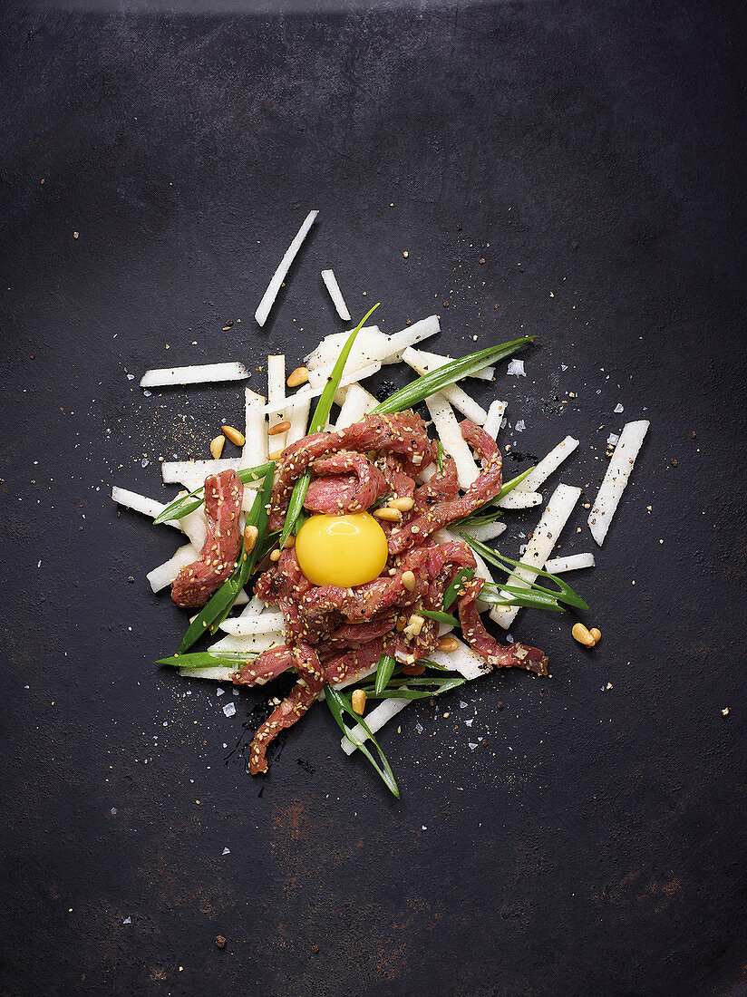 Korean meat salad with nashi pear and raw egg yolk