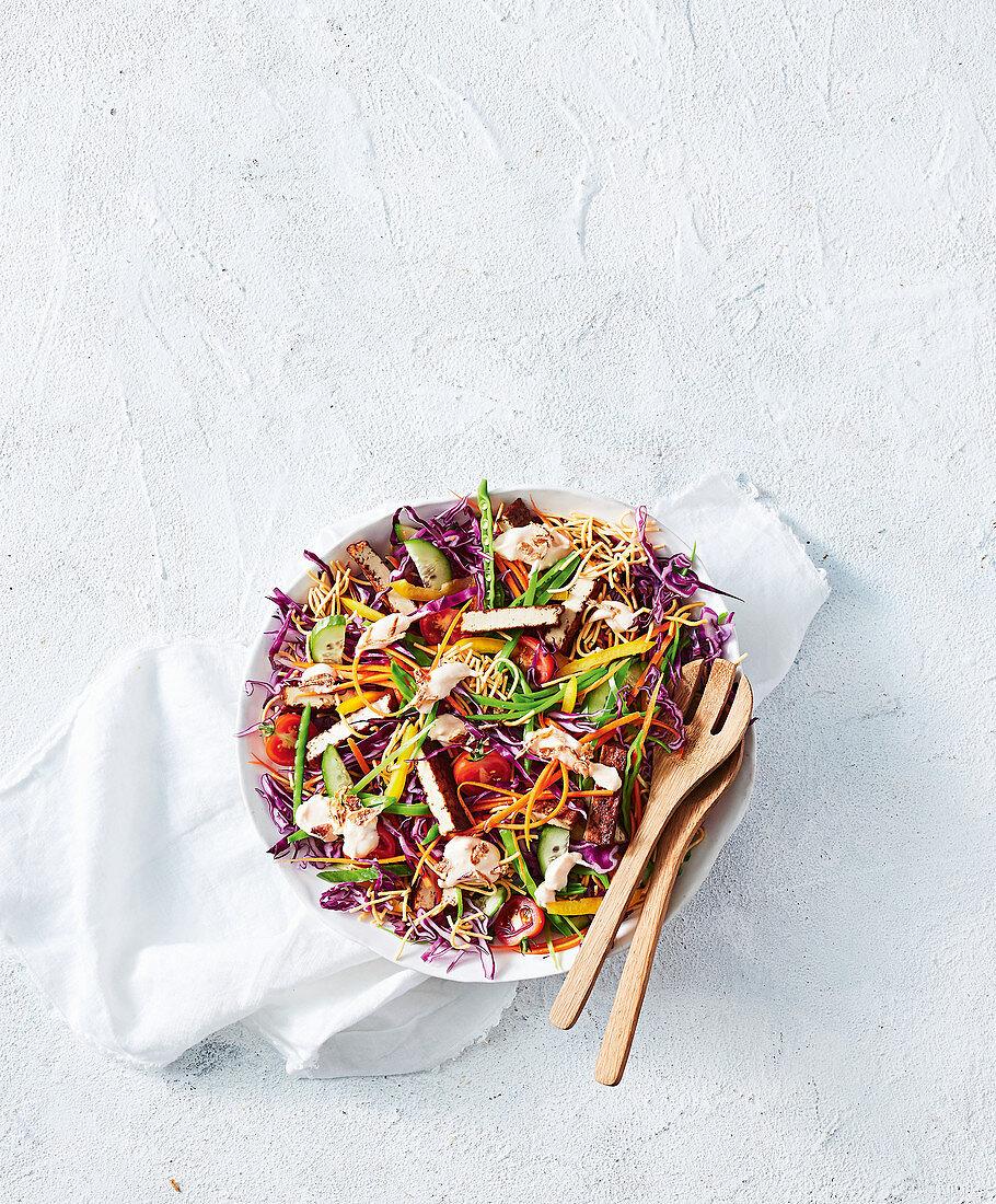 Crispy vegan noodle salad with Japanese teriyaki tofu and vegetable