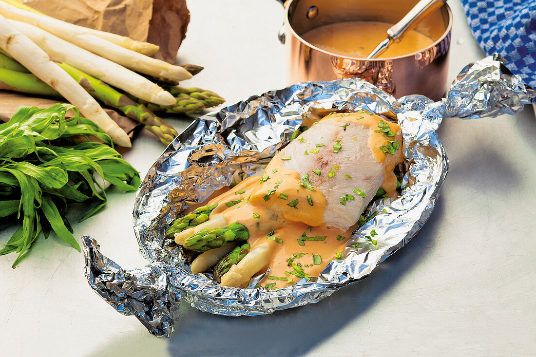 Asparagus and fish parcels with choron sauce