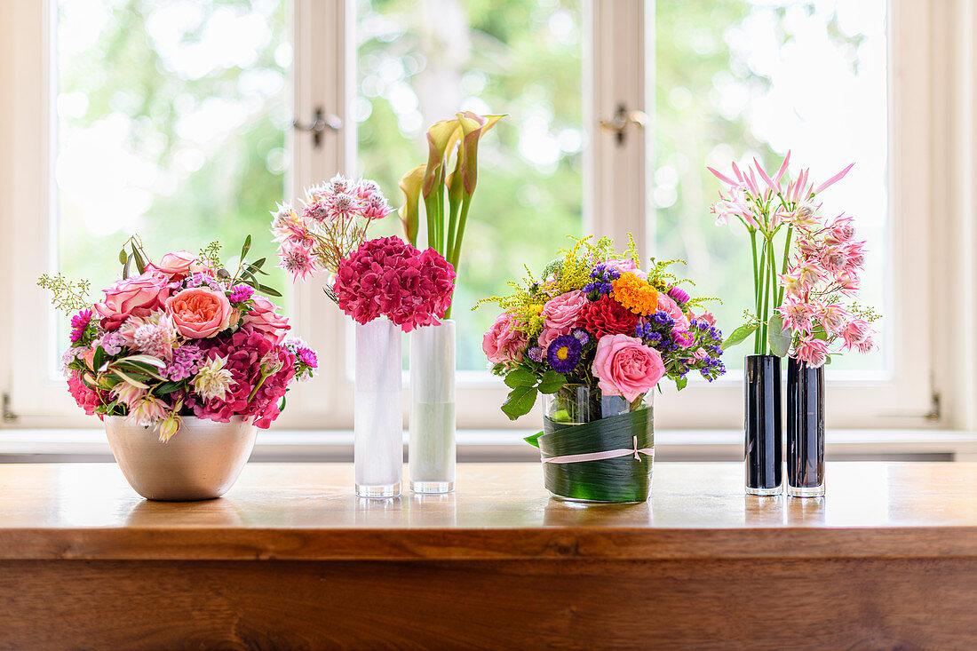 Various flower arrangements decorating table