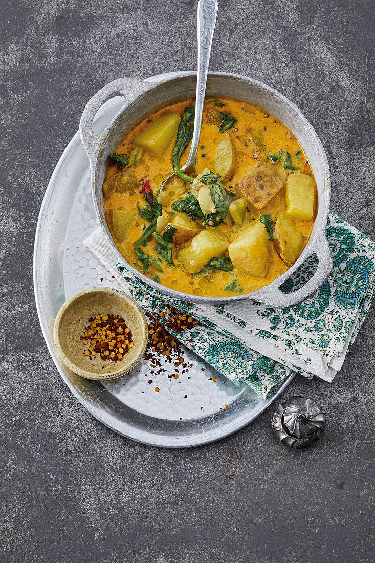 Creamy 'Bollywood' curry made with potatoes, coconut milk and baby spinach