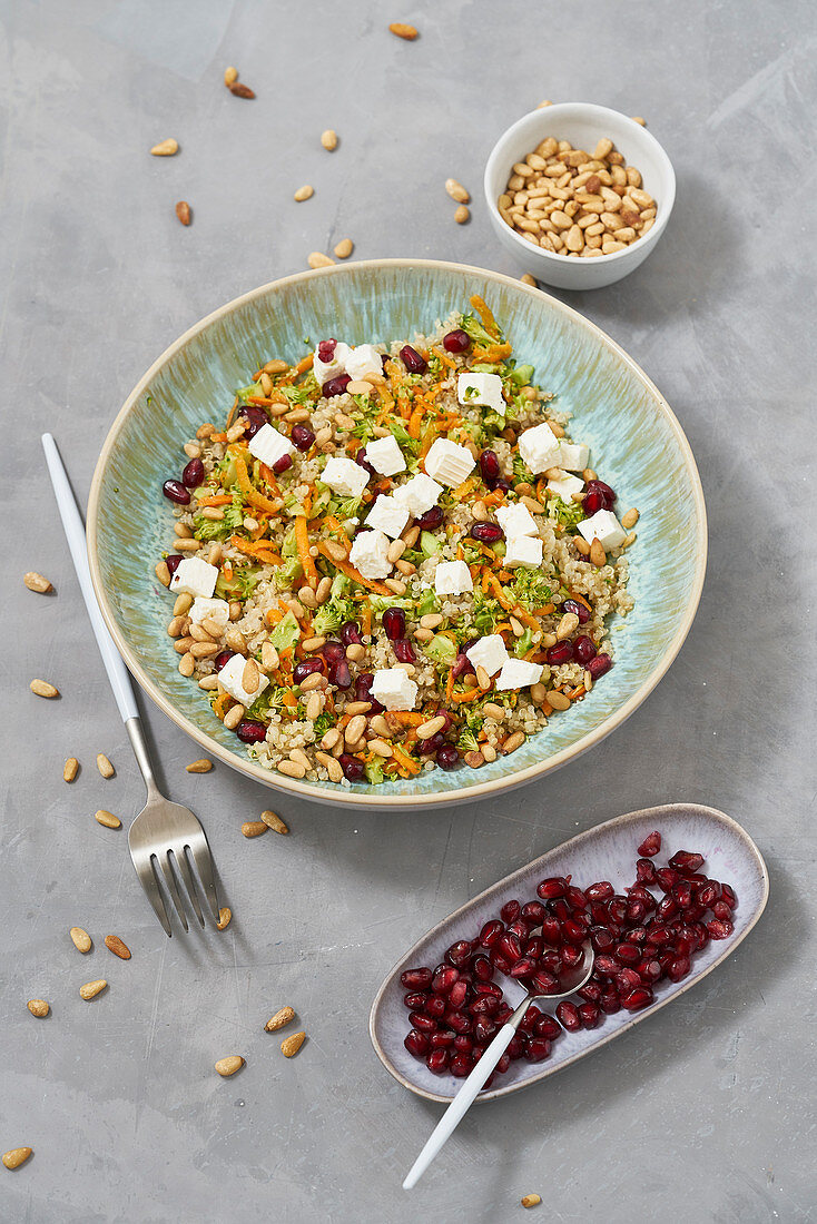 Broccoli power salad with pomegranate seeds and feta cheese