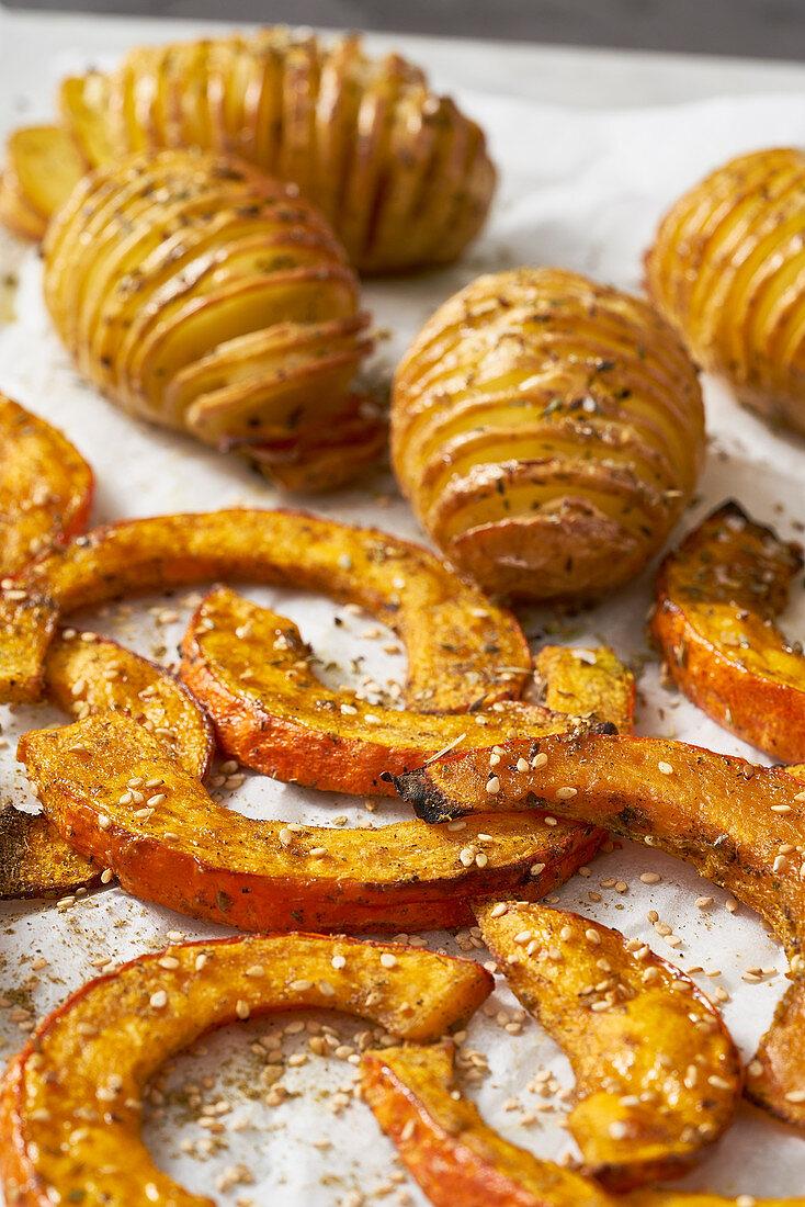 Hasselback potatoes, and oven-roasted za'atar pumpkin