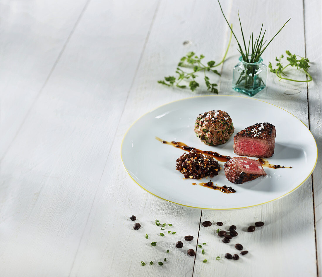 Wagyu teres major made in a Beefer with beef tartare, coffee lentils and olive jus