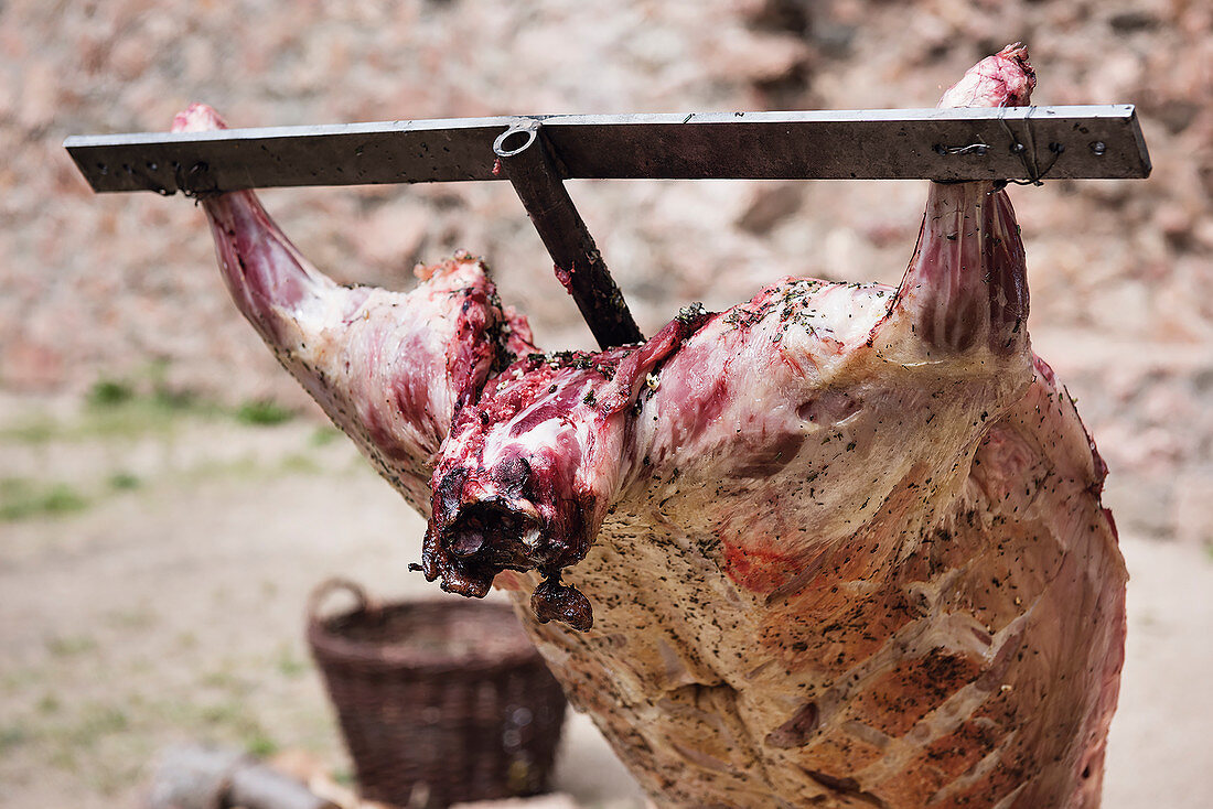 Whole lamb grilled on a cross