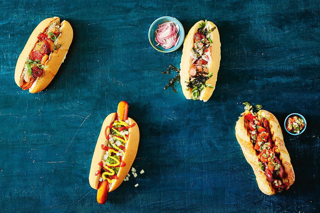 Four hot dog varieties - Queensland snag, Dodger dog, Argentinian choripan, Japanese hot dog