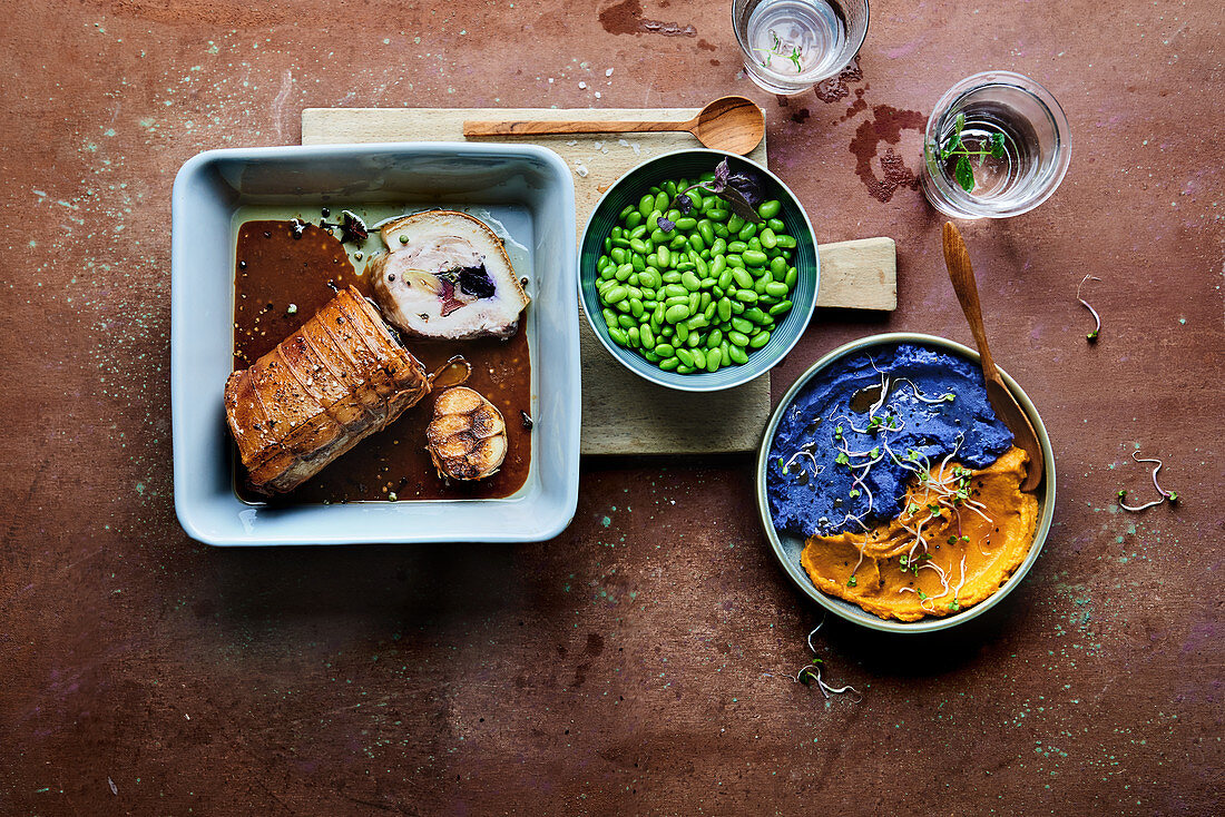 Pork belly filled with rhubarb and beetroot served with edamame and vegetable purée