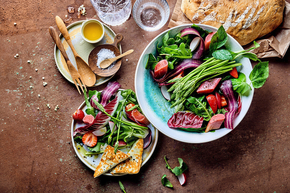 Rhubarb salad with wild asparagus, strawberries, radicchio, oak leave lettuce and grilled cheese