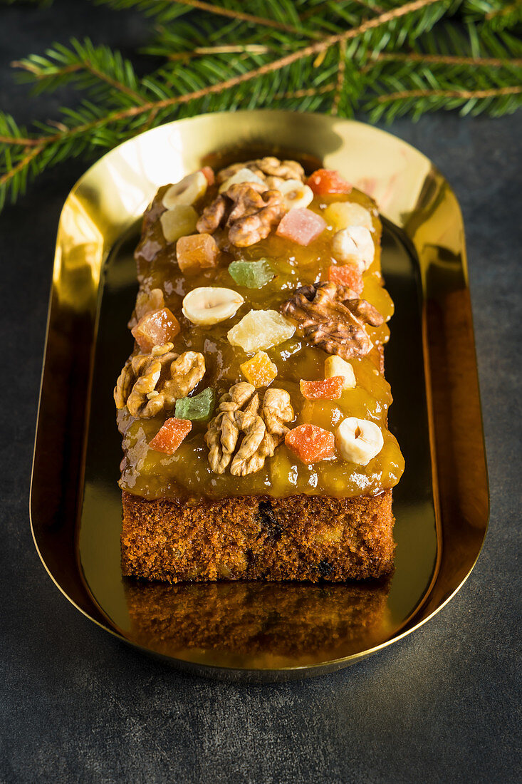 Christmas fruit cake with nuts, spices and sweet fruits