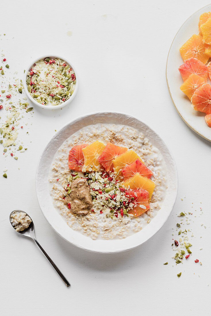 Oatmeal with oranges pumpkin seeds and peanut butter