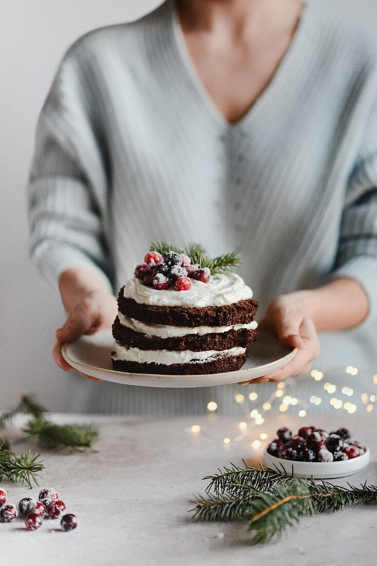 Christmas chocolate sponge cake with ricotta cream with fresh cranberry