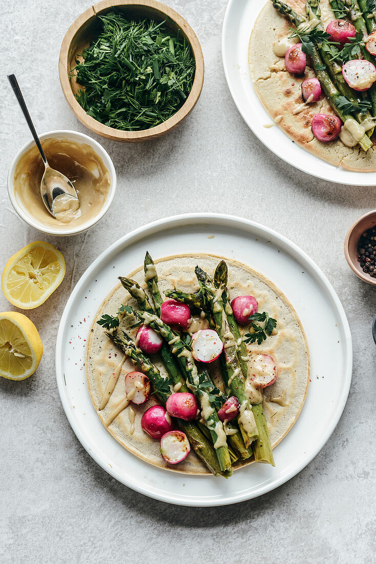 Chickpea pancakes with asparagus roasted radish topped with tahini sauce
