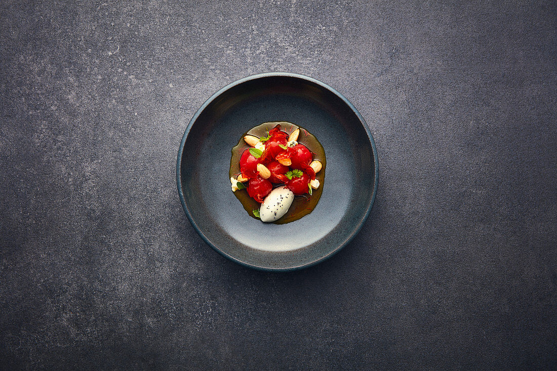 Marinated cherry tomatoes with Castello Blue ice cream and saffron broth