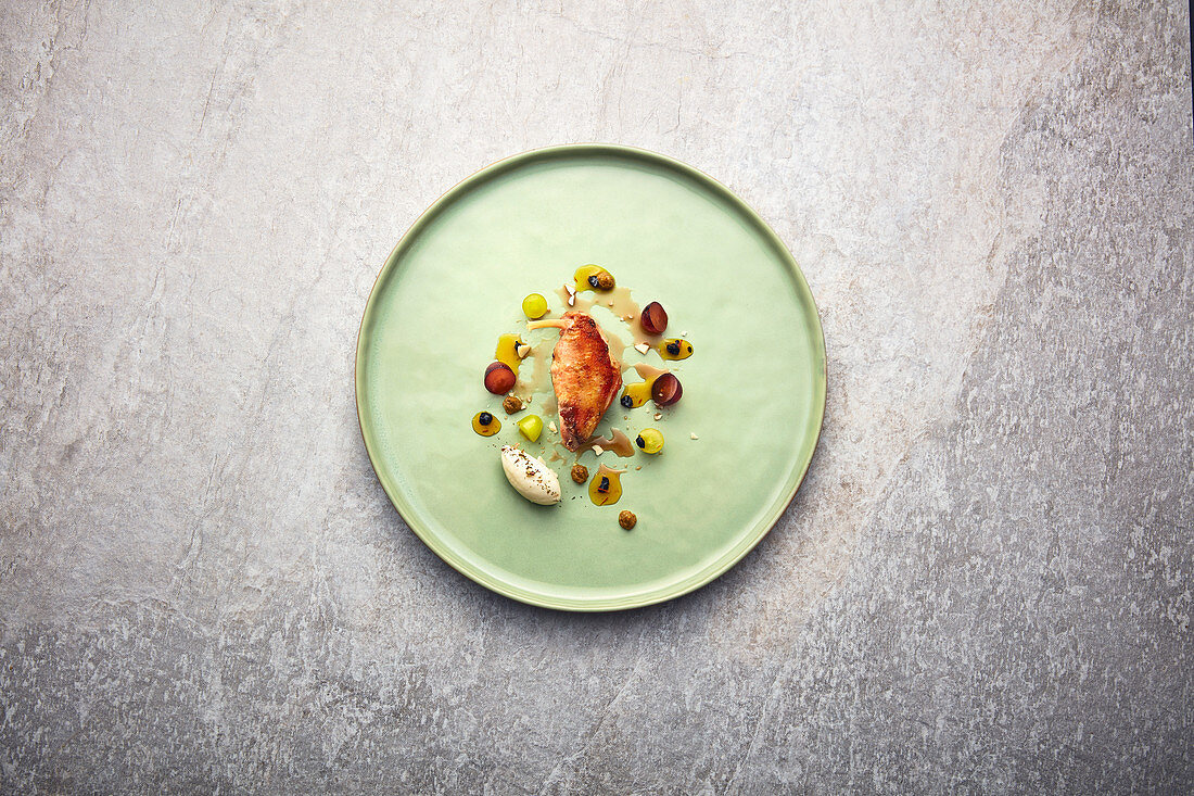 Sous vide partridge with grapes, barberries and birch wood ice cream