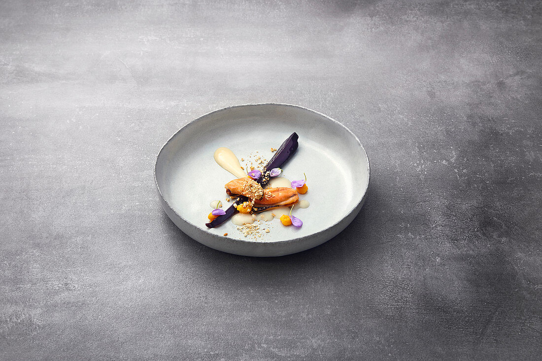 Fermented rice cream with a mussel sauce and mashed carrots