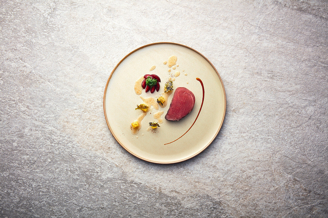 Pork fillet with apple, cherry and fried algae